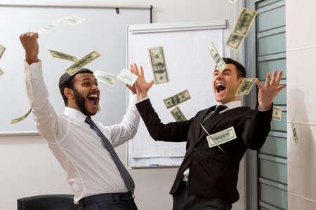 rejoice: Businessmen rejoice of profits. Successful managers scatter dollars.