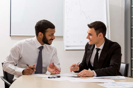 corporate executive: Managers are discussing large-scale project. Partners in the negotiations. Stock Photo