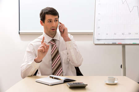 conducts: Manager communicates by phone. Successful manager conducts telephone conversations. Stock Photo