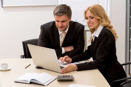 clerks: Clerks preparing a business contract. Clerks in the office. Stock Photo