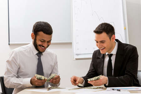 careerist: Successful clerks  count the money. Large sale. Business success.