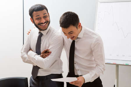 careerist: Managers enjoyed the success. Smiling businessmen in office. Successful men.