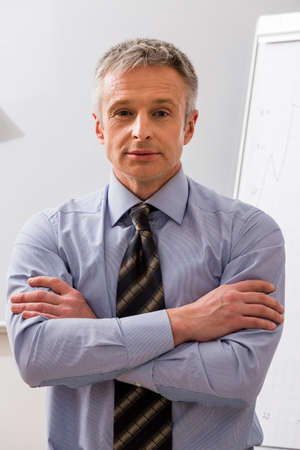 authoritative: Successful man. Sought-after business coach. Authoritative boss.