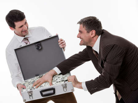 clerks: Businessmen divide profit. Clerks won the jackpot. Business people with suitcase full of money.