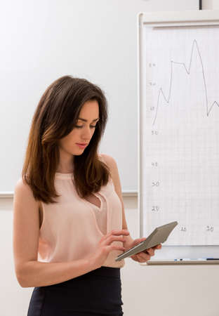 counts: Accountant counts on the calculator. Girl with the calculator. Stock Photo