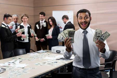 earned: Successful businessmen rejoice the profits. Partners share earned money. Businessmen won the jackpot. Stock Photo