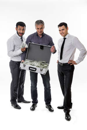 earned: Businessmen have earned a lot of money. Successful people.Young people with a suitcase full of money.