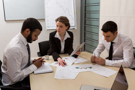 life partners: Boss scolds the manager for not doing the work. Office life. Stock Photo