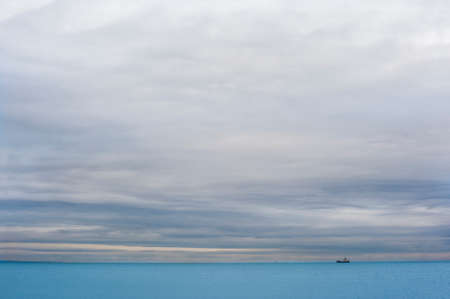 foretaste: The view on the ship on the cloudy horizon from the wedding place. Stock Photo