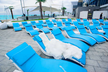 solemnity: The bridal dress is laying on the sunbed in the recreation zone.