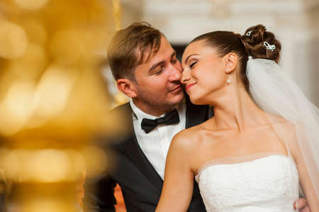 newlyweds: Newlyweds are touching each other with tenderness Stock Photo