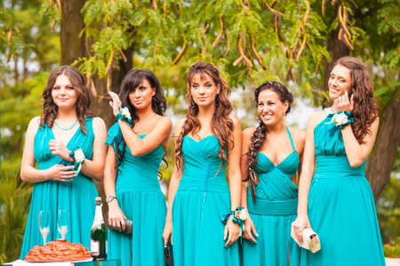 minx: Ukraine, Odessa 07.09.2013. Five bridesmaids are standing and smiling in the park. Editorial