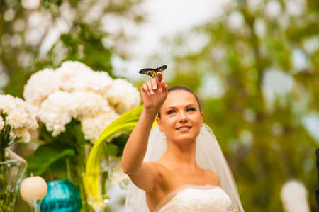 minx: The bride is looking on the yellow butterfly on her finger.