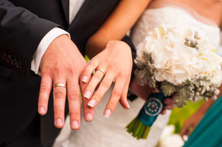 minx: Newlyweds are showing their hands with wedding rings. Stock Photo