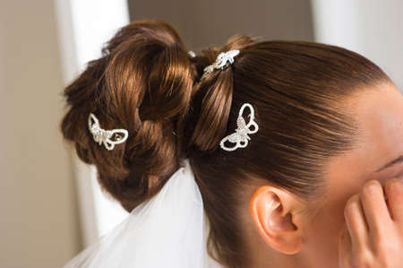 light hearted: Bridal hairstyle is ready for the ceremony. It looks great.