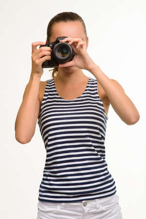 camera girl: Photographer making photo. Paparazzi with camera. Pretty girl posing on white background with camera in her hands.