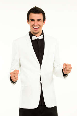 the showman: Young artist enjoying his success. Young excited man on white background. Happy artistic showman.