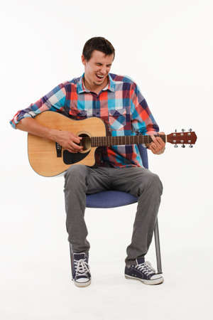 country boy: Musician playing his guitar. Guy singing song. Emotional musician playing guitar on white background.