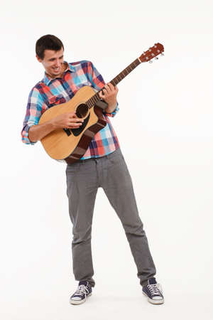guy playing guitar: Joyful guy playing guitar. Singer with guitar sings emotional song. Artistic musician playing guitar. Stock Photo
