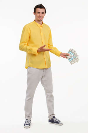 pleased: Young smash director holding money. Executive holding piles of cash. Millionaire with pleased smile.