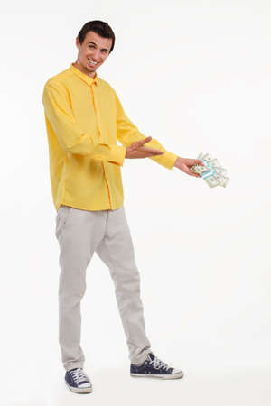 boast: Showman holding pile of cash. Businessman making boast of his money. Lucky artist with a lot of money. Stock Photo