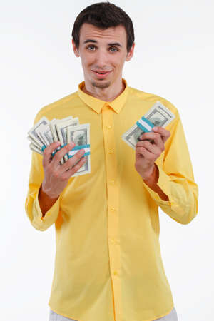 concluded: Rich man holding pile of money. Businessman concluded good bargain. Success executive holding money.