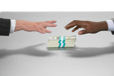 supremacy: Hands reaching for money. Whos first. Duelists or fools. Money is power.
