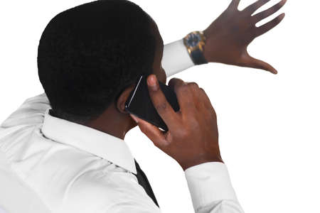 unsatisfied: Topmanager having a phone conversation. Phone negotiations gone wrong. Afroamerican phone arguing. Chief executive unsatisfied. Stock Photo
