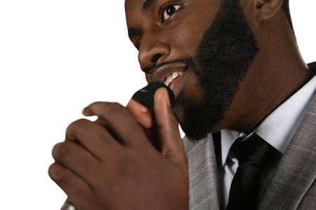 sudio: Talented black singer. Afroamerican vocalist has talent. Retro singer performing. Live sudio singing. Stock Photo