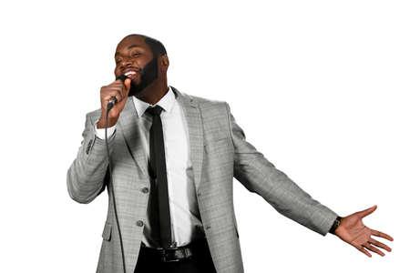 Live performance. Afroamerican singer performing. Black man singing. Elegant afroamerican singing.