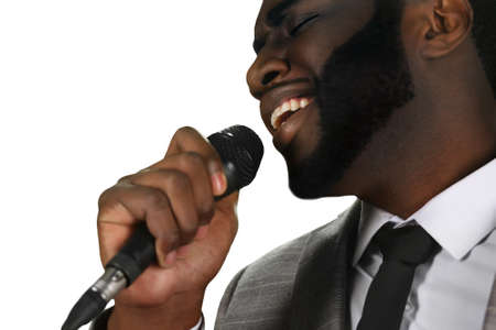 melodist: Darkskinned singer perfrorming. Live singing perfrormance. Black man is singing. Perfromer at his best.