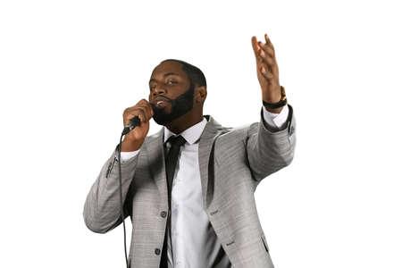preacher: A darkskinned preacher. Praise the Lord. Motivational speech. Follow the light.