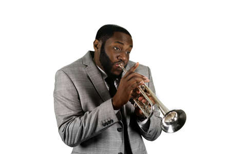 trumpet player: Professional musician on stage. Absorbed trumpet player. Black man playing trumpet music. Jazz perfrormer plays the trumpet.