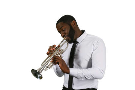 trumpet player: Darksinned musician with a trumpet. Enthusiastic trumpet player. Jazz musician performing. Outstanding trumpet perfromance. Stock Photo
