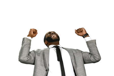 achievment: The moment of joy. Success is everything. The happiness of businessman. Businessmans emotions.