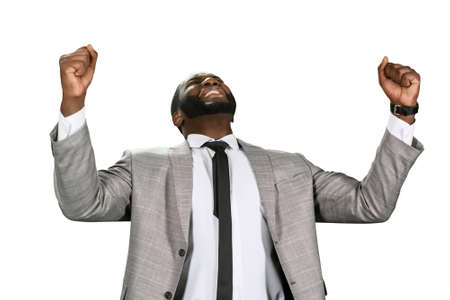 achievment: The businessmans victory. A task acomplished. Black man celebrating sucess. He tried hard and won.