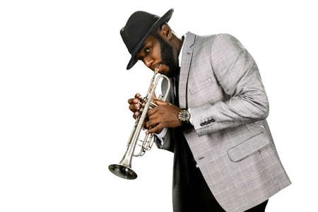 trumpet player: A bearded trumpet player. Classy jazz musician. The expression of talent. Classic trumpet performance. Stock Photo