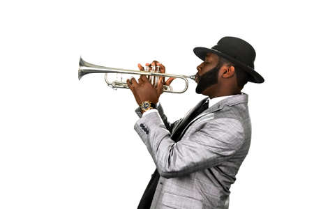 jazz music: A bearded musician. Classy jazzman. A gifted trumpet player. Stylish musician with a trumpet.