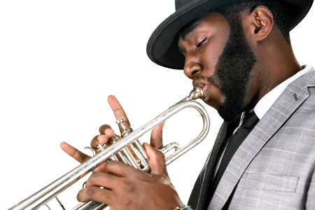 absorbed: An absorbed musician. Enthusiastic jazz player. Professional plays the trumpet. Jazzman with his instrument.