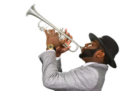 man with hat: Classy jazz style. Jazz star on stage. Trumpeter performing. Stylish musician plays music.
