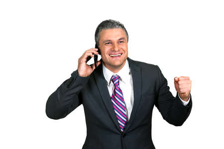 phonecall: Business brings result. Happy to hear good news. Positive attitude. Businessmans phonecall.