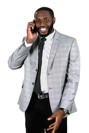Negotiations are successful. A correct desicion. Friendly staff on the phone. Businessmans happy smile. Stock Photo