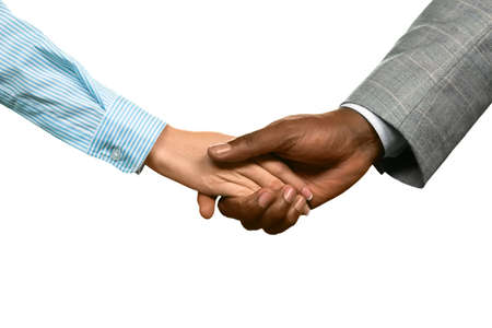 realtionship: Man shakes womans hand. Were glad you came back. A second chance. Appreciate what you have. Stock Photo