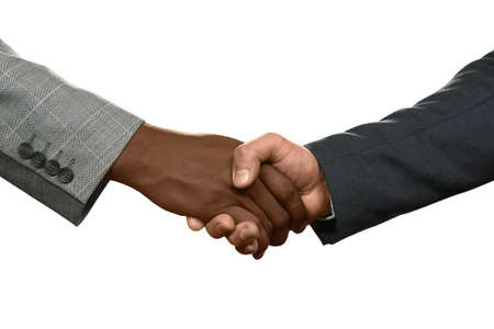 realtionship: Two businessman shake hands. Were partners now. Know your enemy. Honesty or deception. Stock Photo