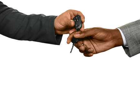 achievment: Man handing keys. Just take my car. A test-drive. A sign of trust. Stock Photo