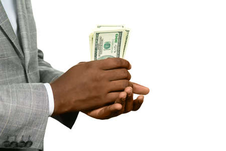mature business man: Black man holding cash. Looks pretty thick. Warm up your pocket. Fresh and crispy.