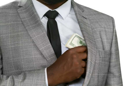 safer: Black man hiding cash. Avoid hungry eyes. Feed the greed. Its safer to hide.