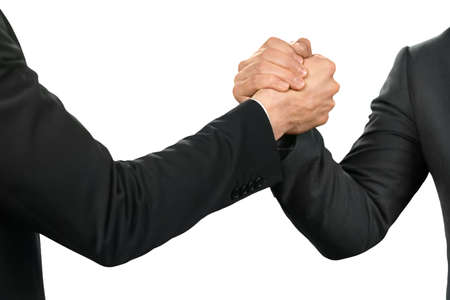 realtionship: Friendly officials shake hands. An alliance is born. Partnership and protection. The strenth of a gesture.