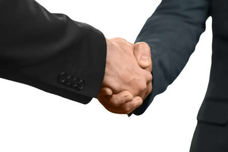 realtionship: Officially dressed men shake hands. Lets make a deal. Welcoming a new partner. Member of a team. Stock Photo