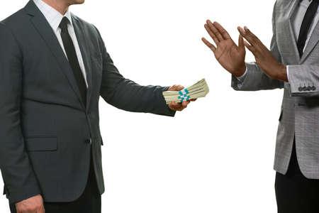 Black man refuses money. Accept no evil. Law-abiding citizen. Honesty and courage. Stock Photo